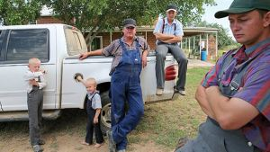 Johan Weiber, leaning on his pickup truck, is the de facto leader of a dissident group of Mennonites in Manitoba.